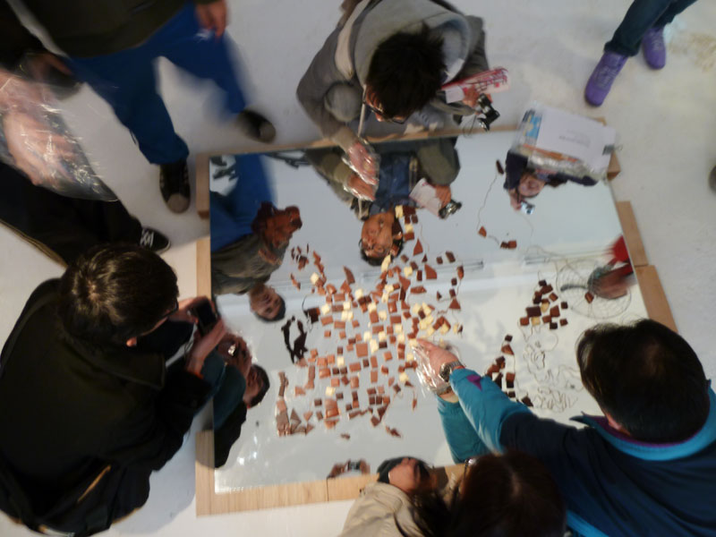 Visitors helping to eat the Chocolate World Map